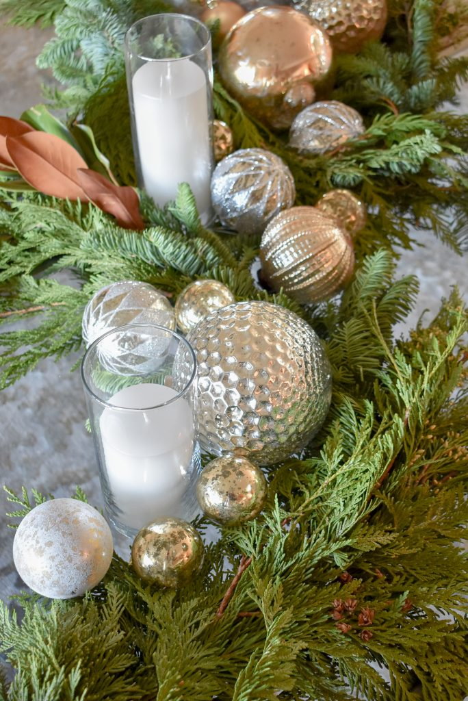 Silver and Gold Christmas Centerpiece with Evergreens with candles in glass hurricanes