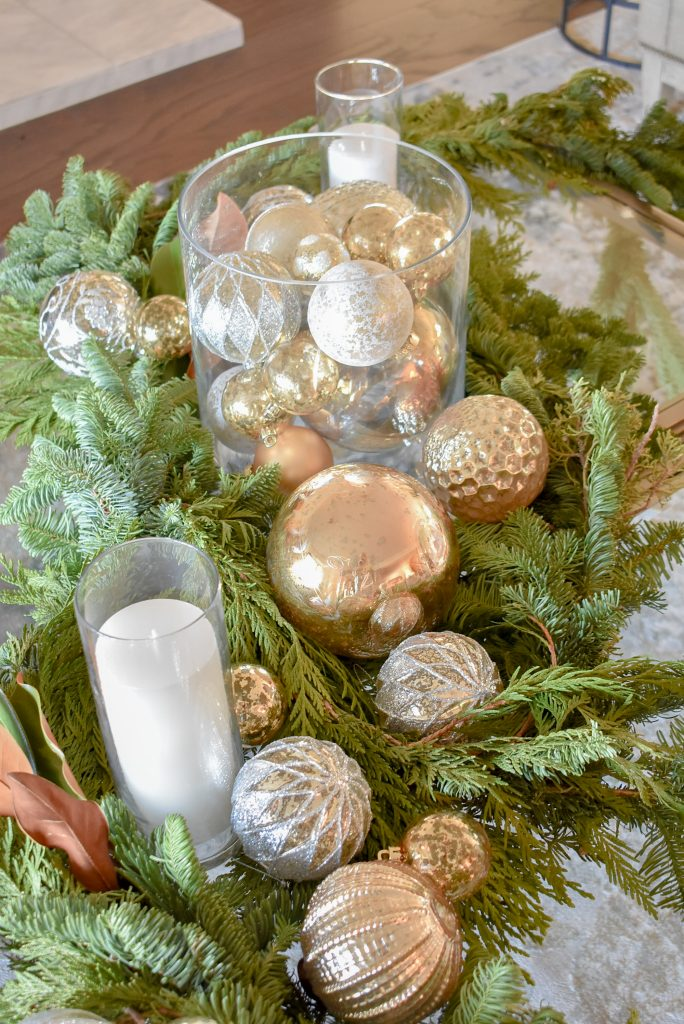 A Silver and Gold Christmas Centerpiece with Evergreens
