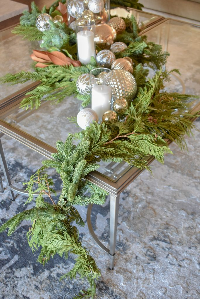 Draping Evergreens on a Silver and Gold Christmas Centerpiece with Evergreens