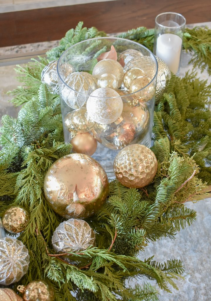 A Silver and Gold Christmas Centerpiece with Evergreens and Christmas ornaments