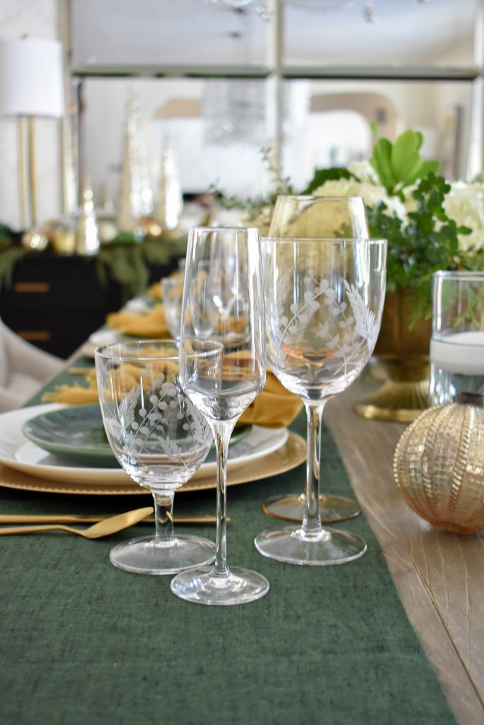 Glassware on Evergreen and Gold Christmas Table Settings