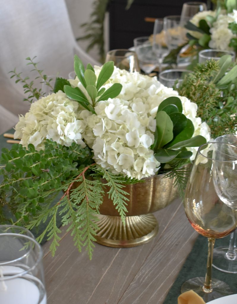 Centerpiece on an Evergreen and Gold Christmas Table Settings
