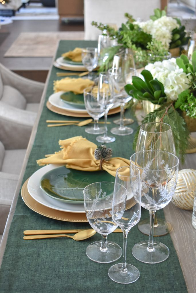 Simple Evergreen and Gold Christmas Table Setting with green table runners