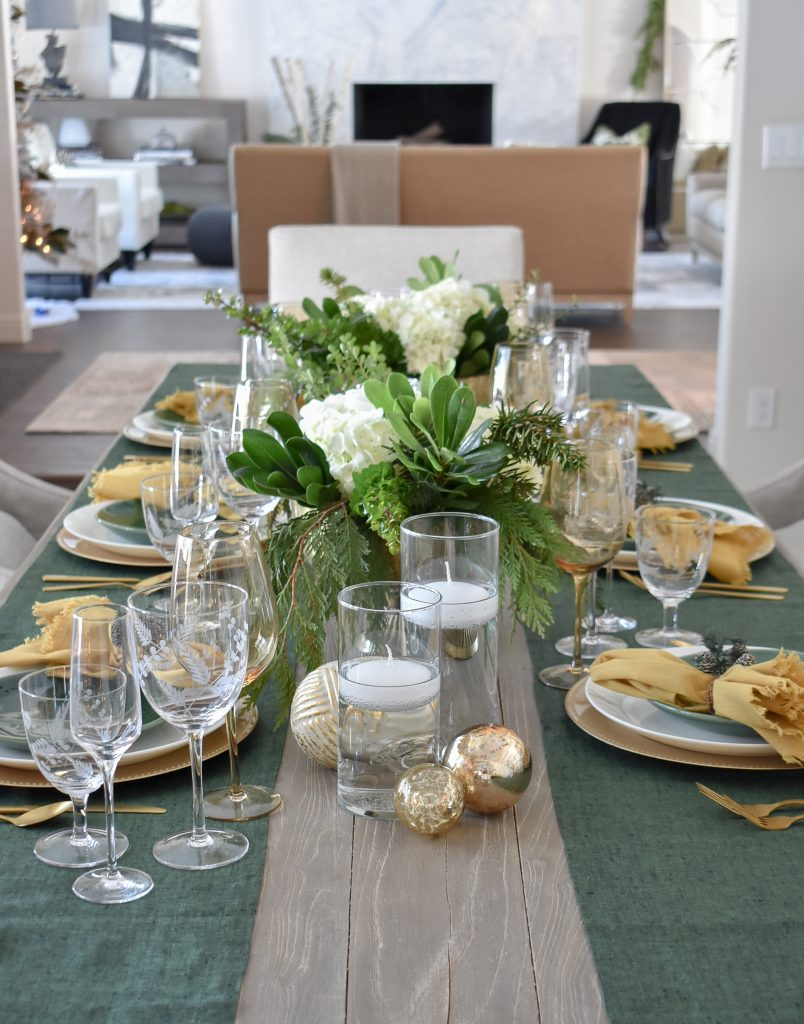 Evergreen and Gold Christmas Table Settings with green runners