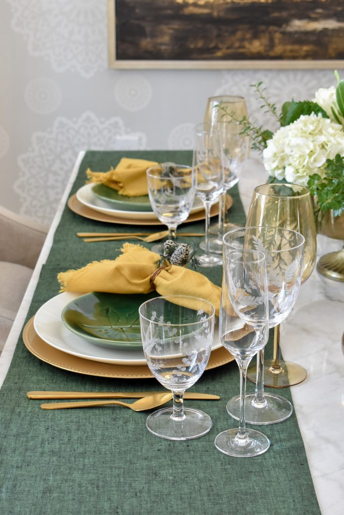 Place Settings on Evergreen and Gold Christmas Table Settings