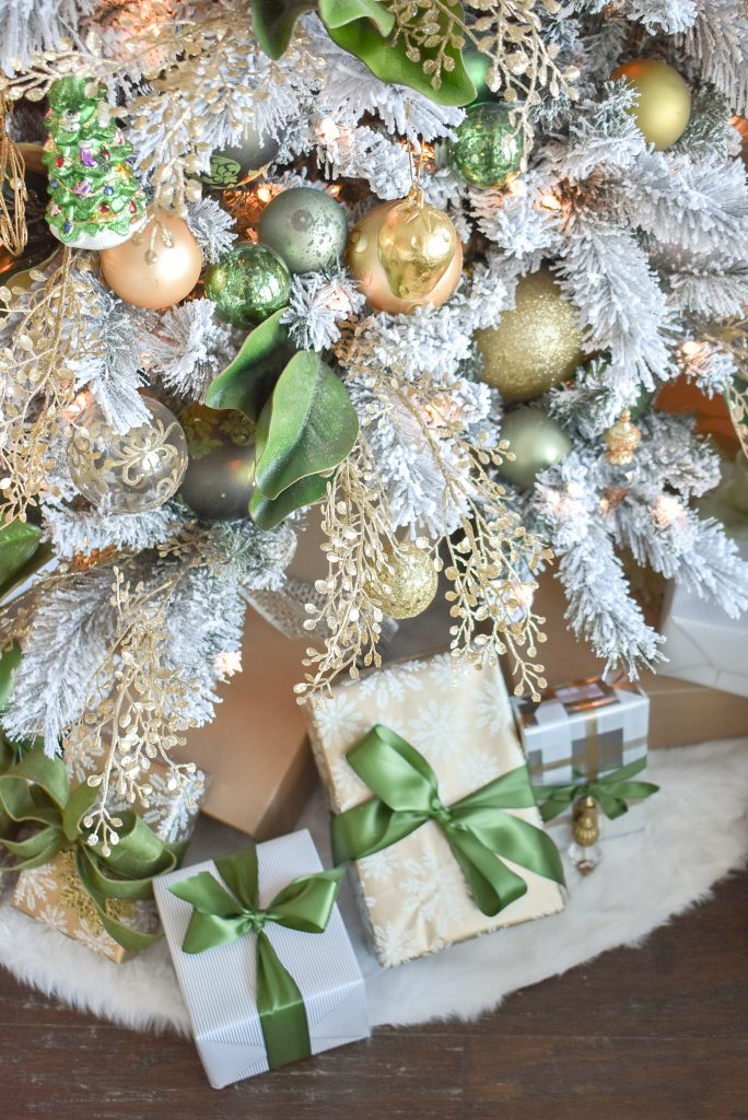 GIfts below a Green and Gold Flocked Christmas Tree