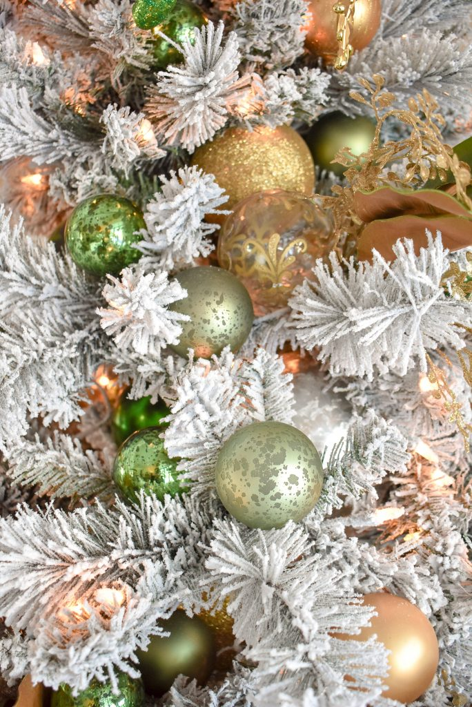 A close-up of Green and Gold Flocked Christmas Tree