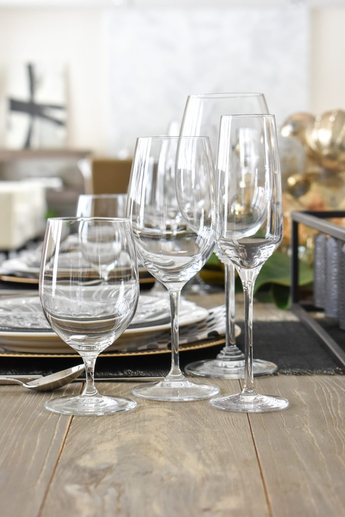 Fine Glassware on a Modern Glam Table Setting with Black and Gold and Silver