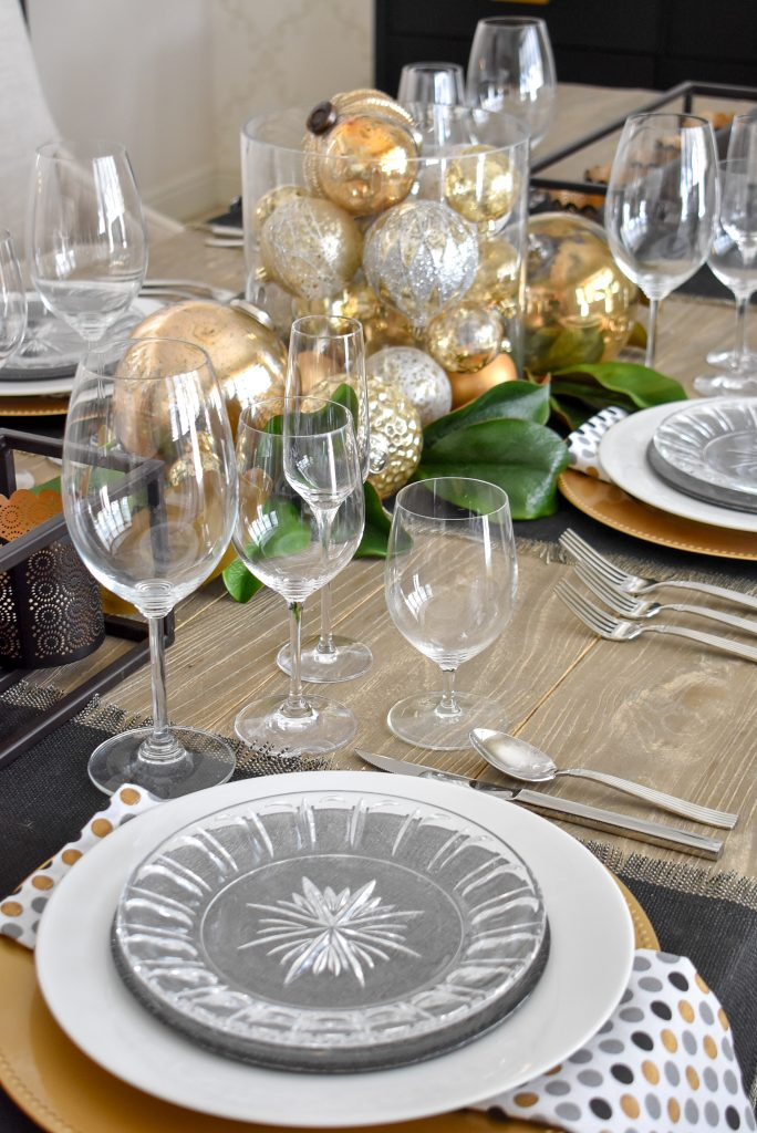 A view of the centerpiece on a Modern Glam Table Setting with Black and Gold and Silver