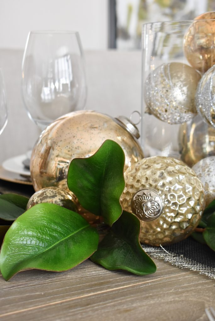 Gold ornaments on a Modern Glam Table Setting with Black and Gold and Silver