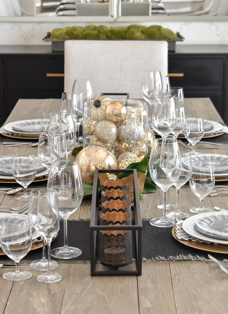 A Modern Glam Table Setting with Black and Gold and Silver