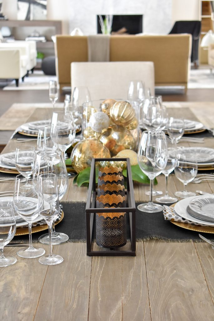 Centerpiece on a Modern Glam Table Setting with Black and Gold and Silver
