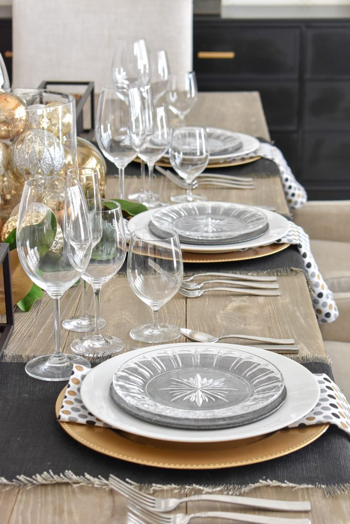 Place settings on a Modern Glam Table Setting with Black and Gold and Silver