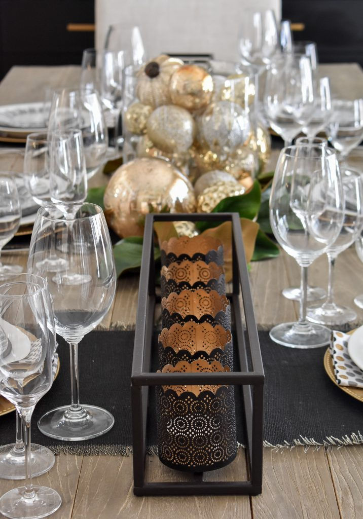 Black centerpiece on a Modern Glam Table Setting with Black and Gold and Silver