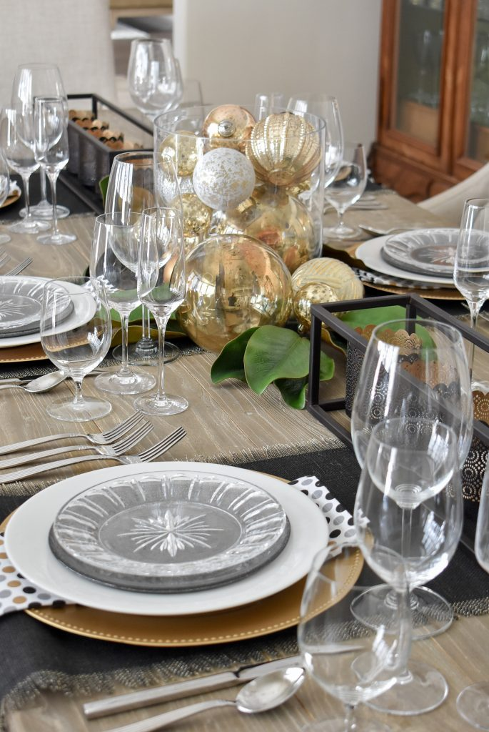 Side view of a Modern Glam Table Setting with Black and Gold and Silver for the New Year