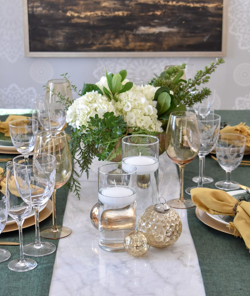 Simple White and Evergreen Christmas Centerpieces for two tables