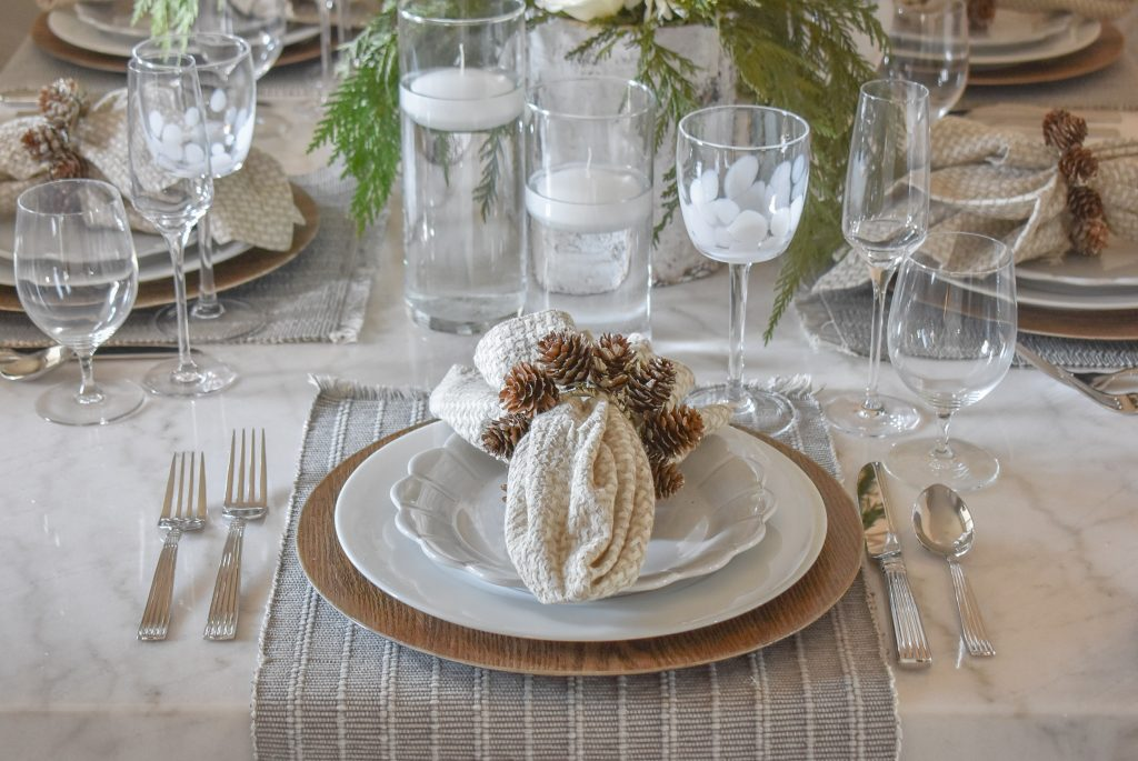 Place Setting on a White Woodsy Christmas Table Setting