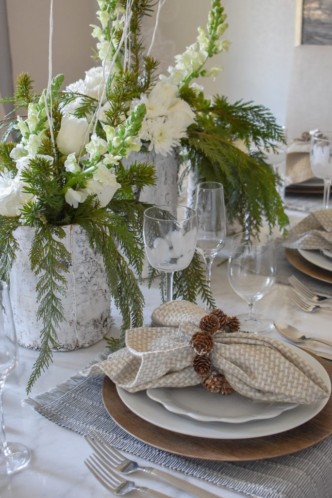 A White Woodsy Christmas Table Setting