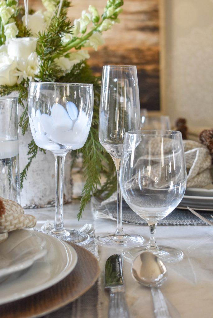 Glassware on a White Woodsy Christmas Table Setting