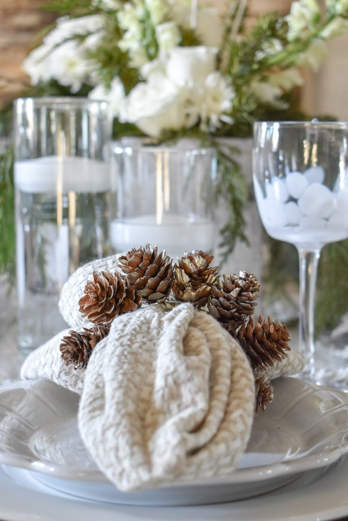 Napkins with Pine Cones on a White Woodsy Christmas Table Setting