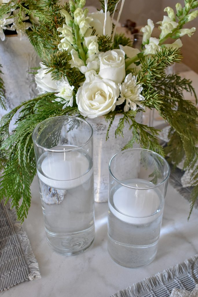 Floating Candles on a White Woodsy Christmas Table Setting
