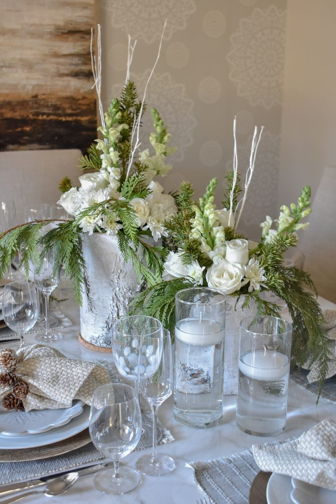 White flower arrangements on a White Woodsy Christmas Table Setting