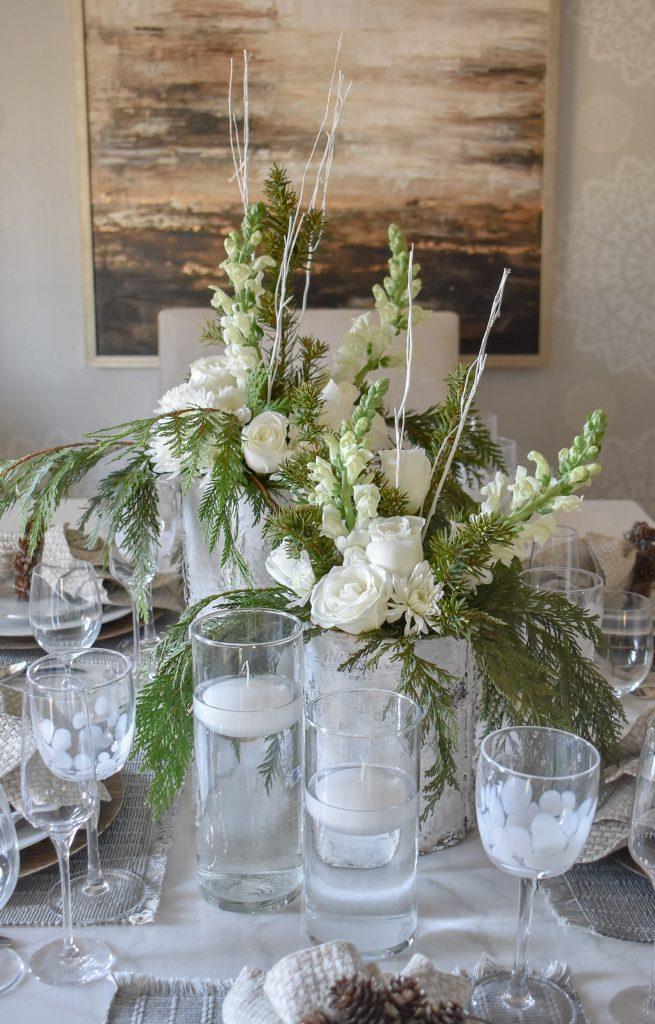 An Elegant White Woodsy Christmas Table Setting