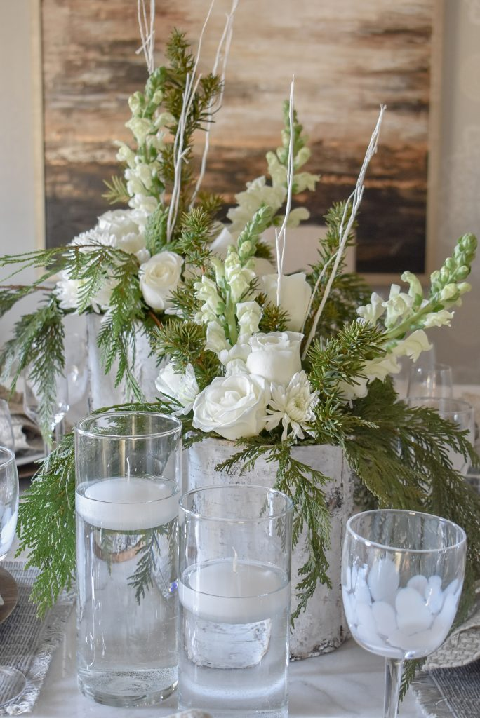 Flowers on a White Woodsy Christmas Table Setting