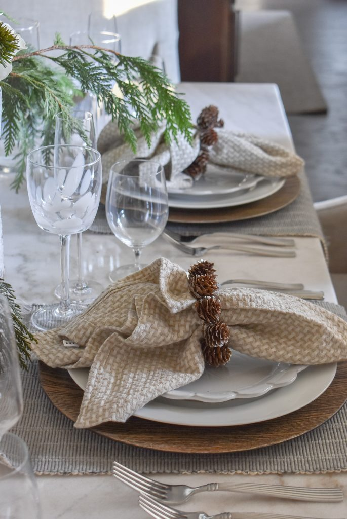 Place Settings on a White Woodsy Christmas Table Setting