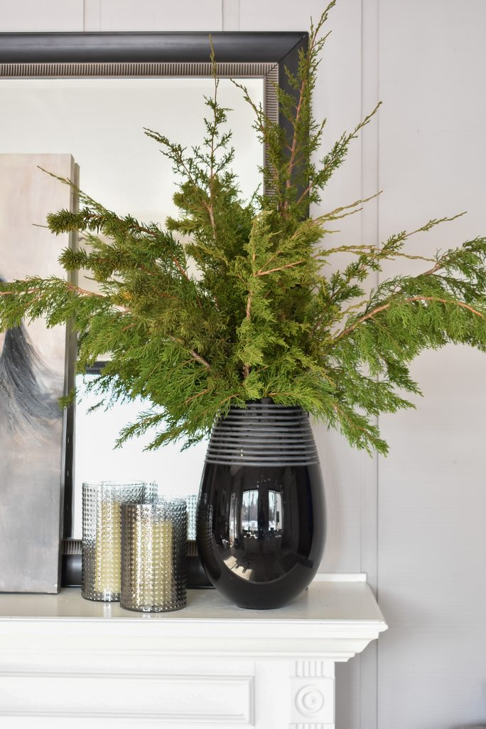 Winter evergreens in a black vase