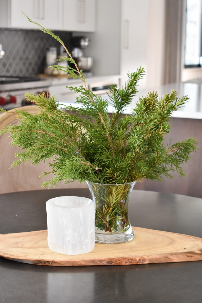 Tips to Transition your Decor from Christmas to Winter with candles and fresh evergreens