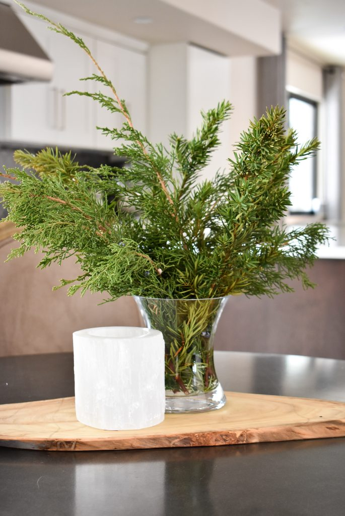 Winter evergreens in a vase to help Transition your Decor from Christmas to Winter