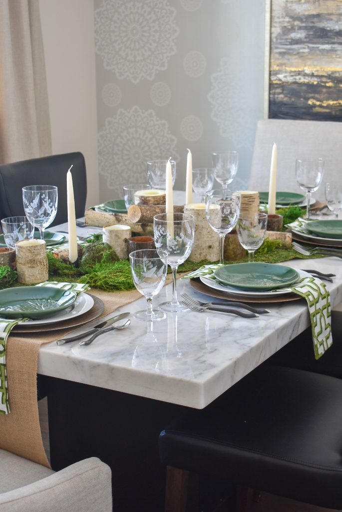 A Green and White Woodsy Table Setting for Spring or St. Patrick's Day on a marble table