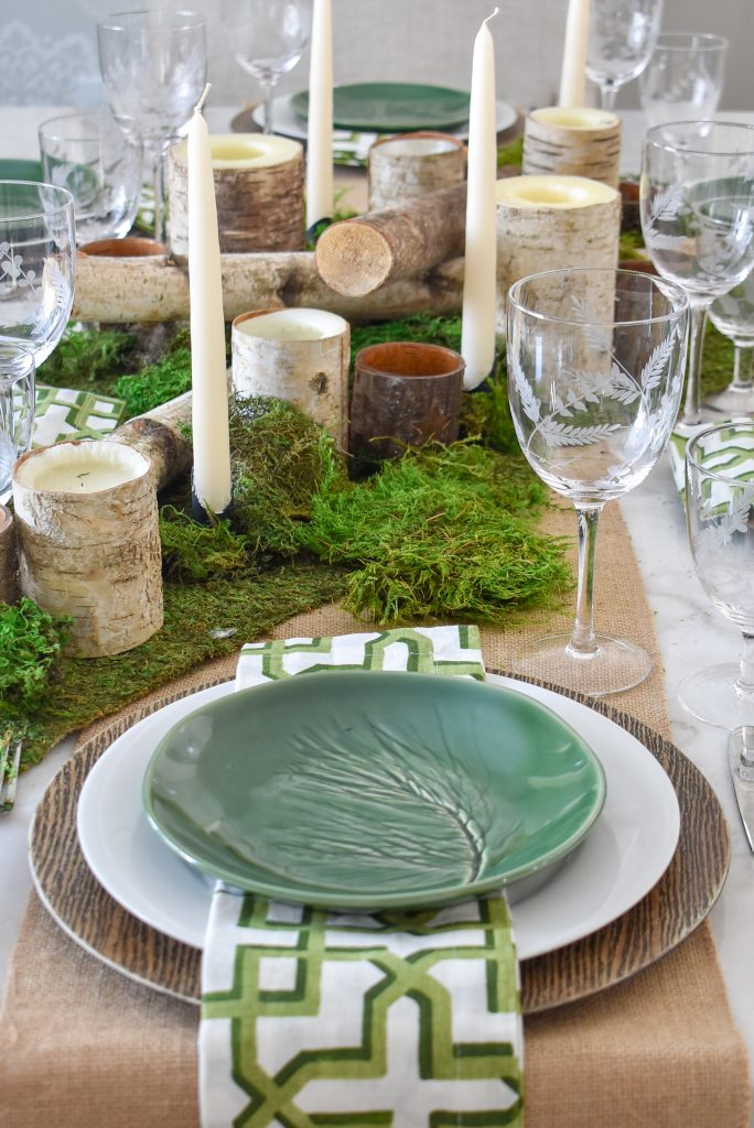A Green and White Woodsy Table Setting for Spring or St. Patrick's Day with moss and wood candles
