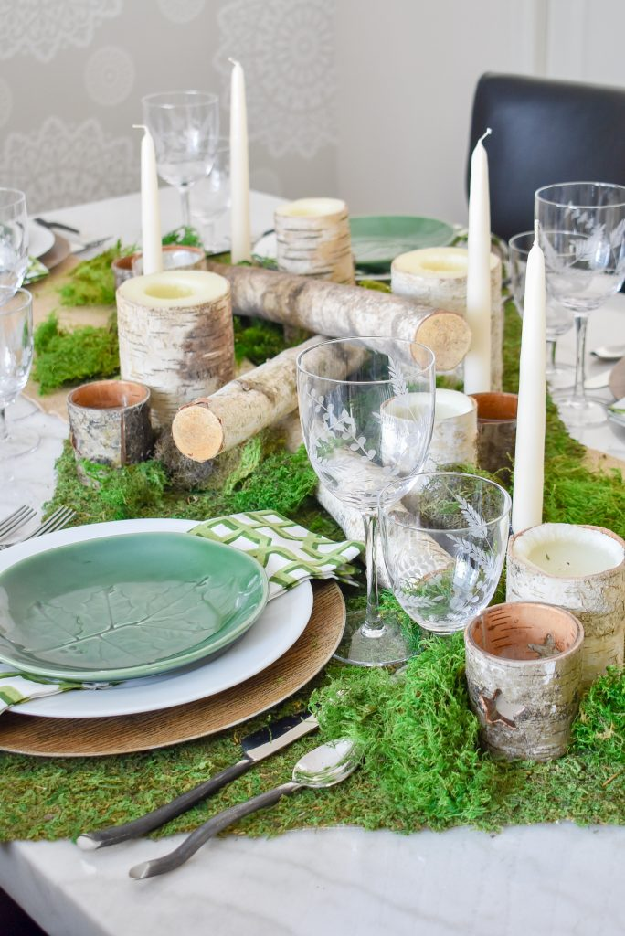A Green and White Woodsy Table Setting for Spring or St. Patrick's Day on a moss runner