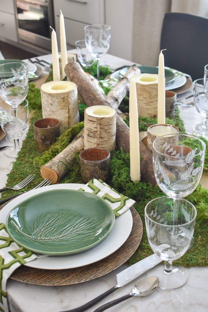 The centerpiece on a Green and White Woodsy Table Setting for Spring or St. Patrick's Day