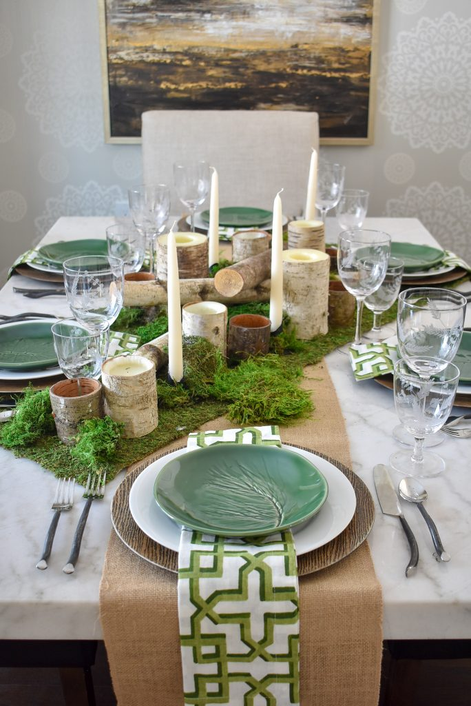 A Green and White Woodsy Table Setting for Spring or St. Patrick's Day with a burlap and moss runner