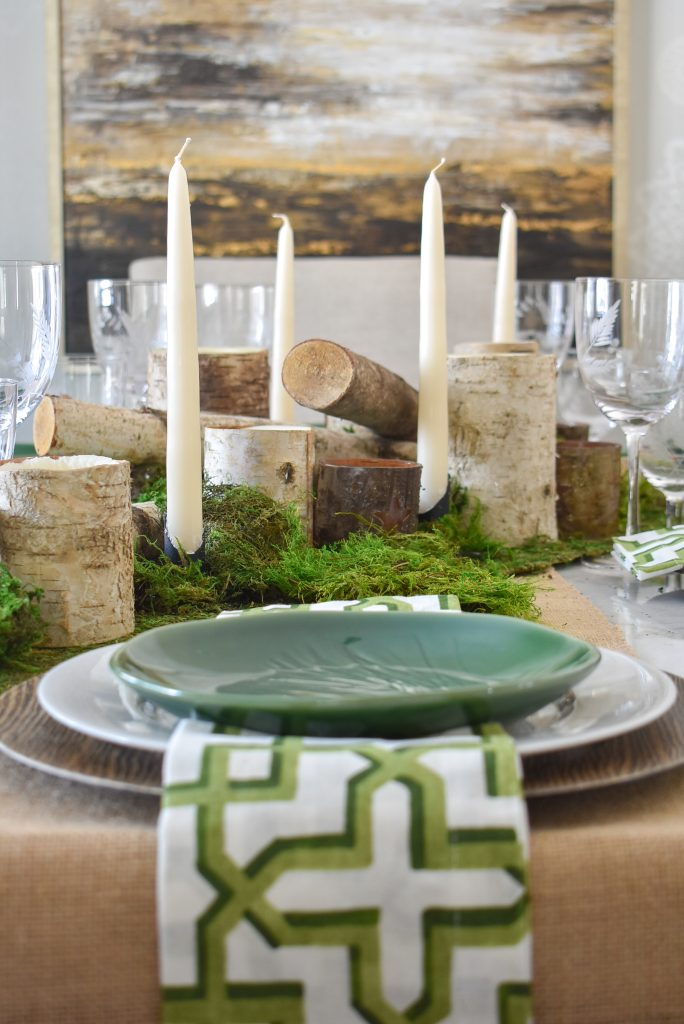 A Green and White Woodsy Table Setting for Spring or St. Patrick's Day with moss and candles