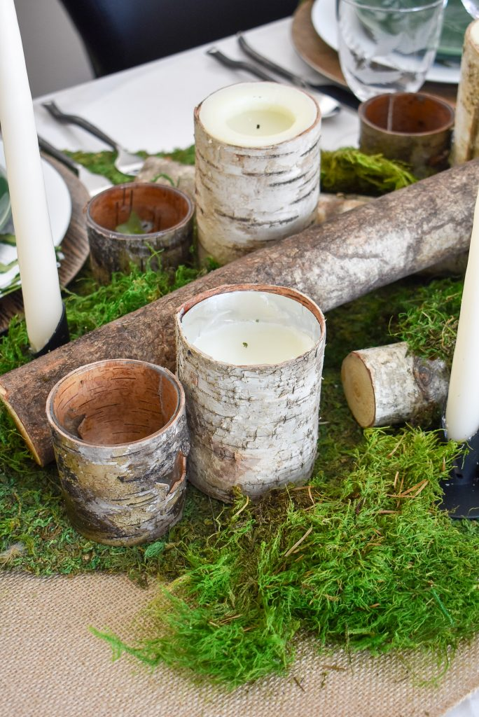 A Green and White Woodsy Table Setting for Spring or St. Patrick's Day with birch candles and moss