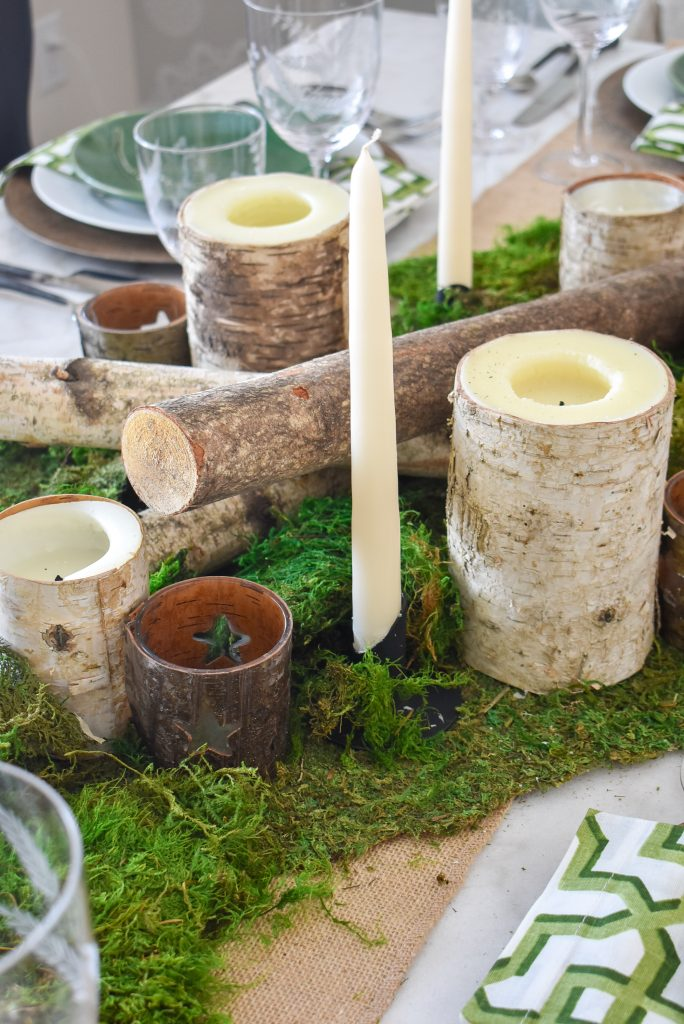 Candles on a Green and White Woodsy Table Setting for Spring or St. Patrick's Day