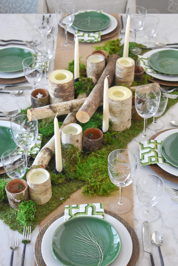A Green and White Woodsy Table Setting for Spring or St. Patrick's Day with a moss runner