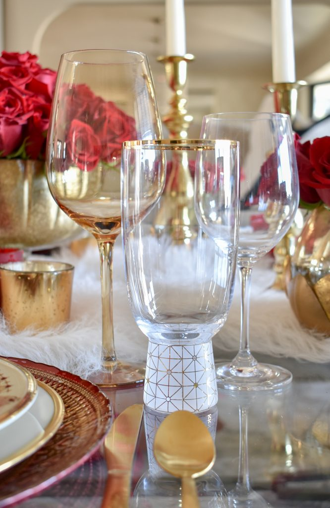 The Stemware on a Romantic Red and Gold Valentine's Day Table for Two