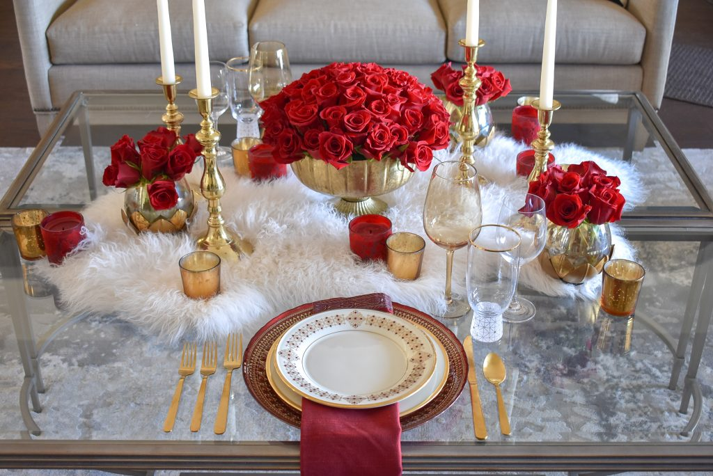 A Romantic Red and Gold Valentine's Day Table for Two on a faux fur throw