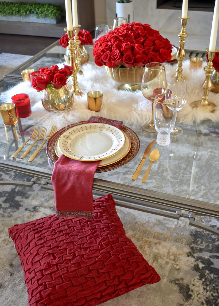 A Romantic Red and Gold Valentine's Day Table for Two set on coffee tables