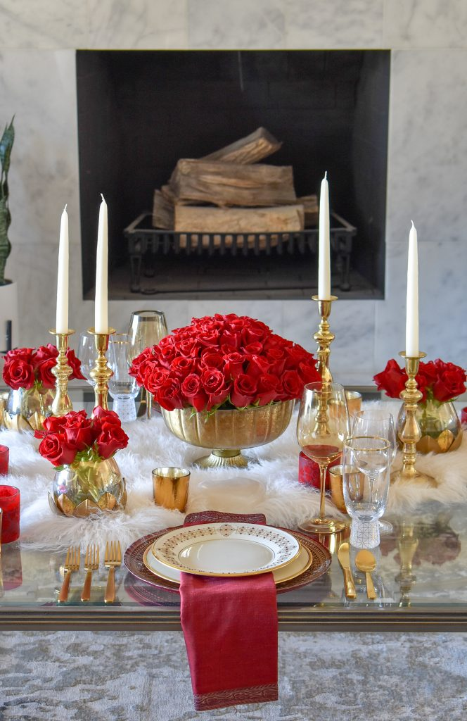 A Romantic Red and Gold Valentine's Day Table for Two in front of a fireplace