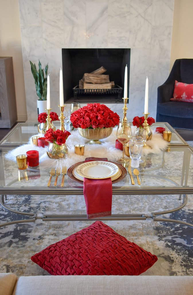 A Romantic Red and Gold Valentine's Day Table for Two in a living room
