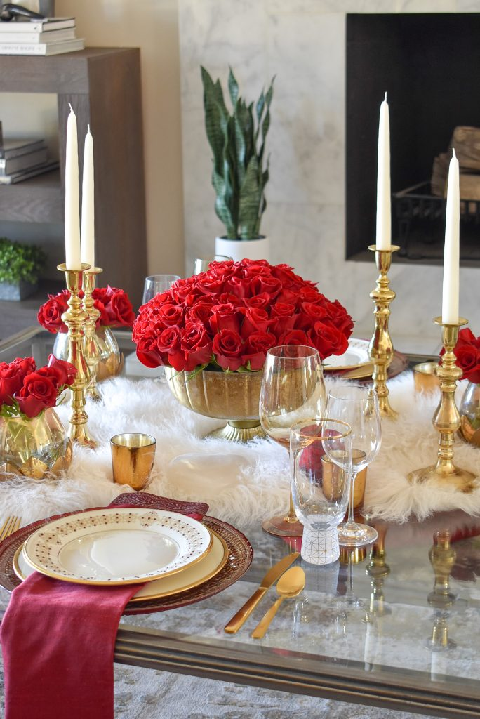 A Romantic Red and Gold Valentine's Day Table for Two on a coffee table