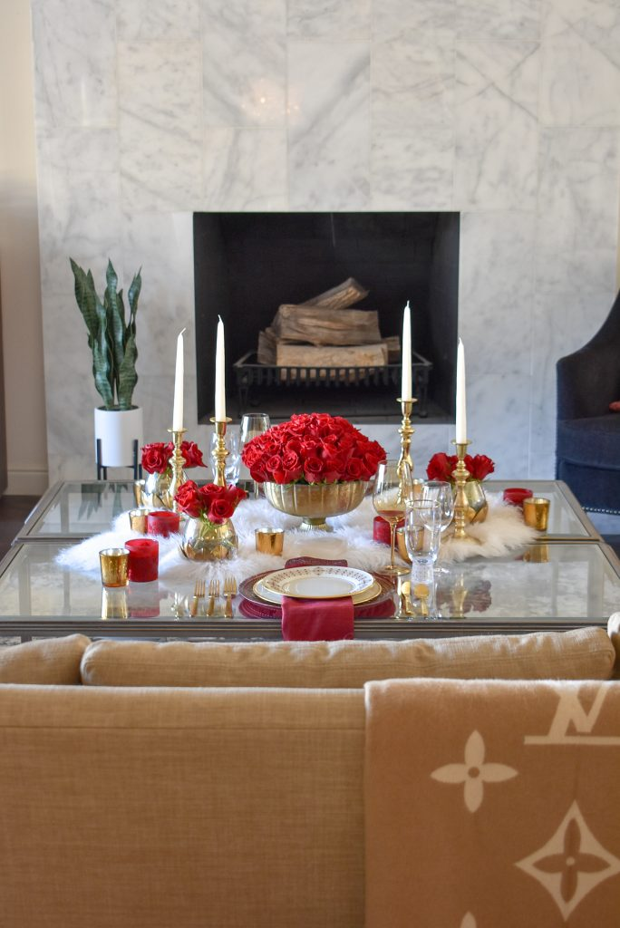 A Romantic Red and Gold Valentine's Day Table for Two set in a Living Room