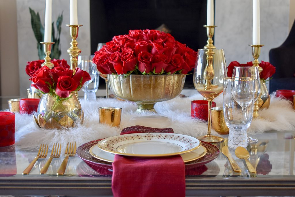 A Romantic Red and Gold Valentine's Day Table for Two on a set of coffee tables