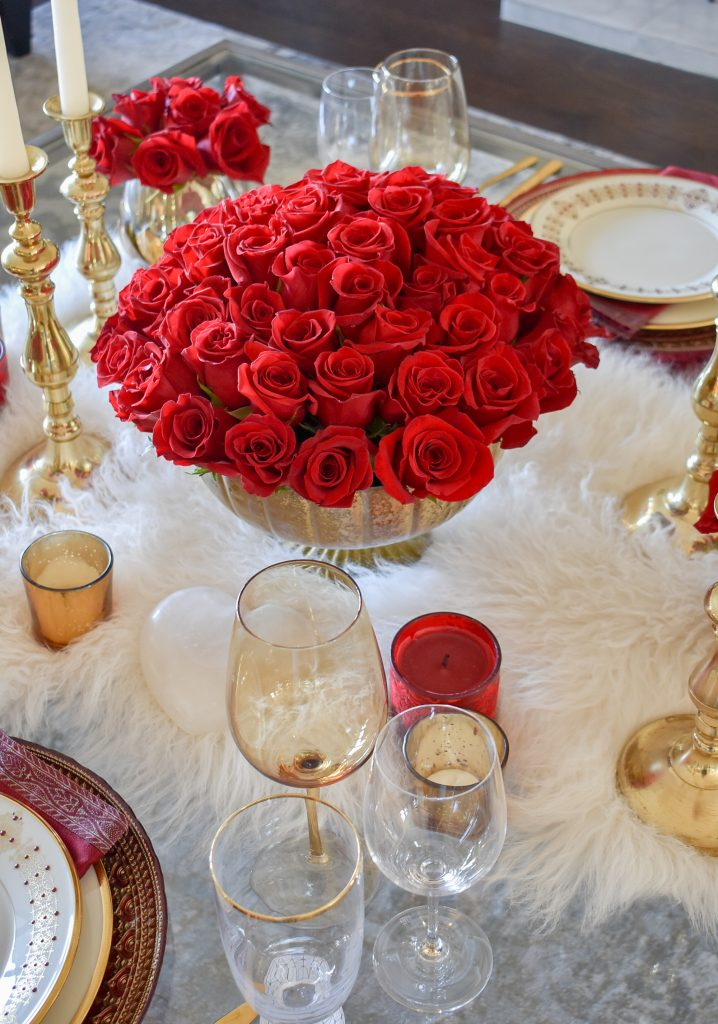 The roses on a Romantic Red and Gold Valentine's Day Table for Two